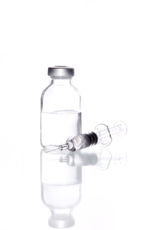 Glass Medicine Vial and glass syringe  for Injecting medicine on a white background