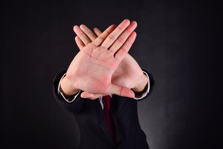 non verbal: business man,with hands signaling to stop work