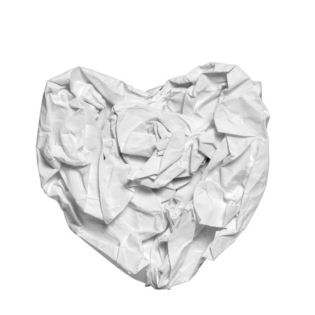 crumpled paper heart shape  isolated on white background (concept for broken love heart) photo