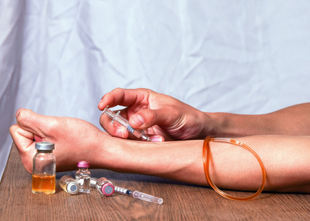 self dependent: patient self  drug injection Stock Photo