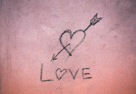 blanche: Written love sign with cinder on cement wall