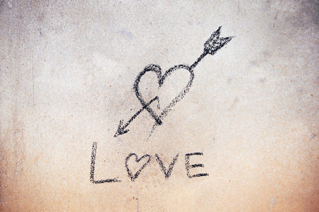 cinder: Written love sign with cinder on cement wall