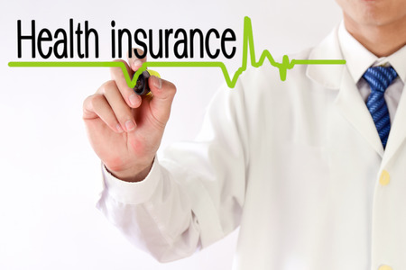 insurance: Blurred Doctor writing Health insurance concept