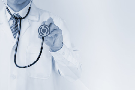 emergency care: Blurred doctor with stethoscope Stock Photo