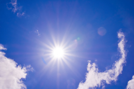 Beautiful blue sky with clouds  and  sunbeams ,sun flare. Stock Photo