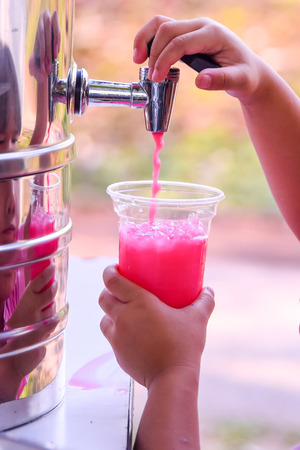 relieve: Children, press the pink milk into a glass.Cold drink relieve hot well.