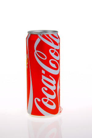 PATTAYA, THAILAND -April 3, 2015: Coca-Cola new design can package and ice on white background. Coca-Cola is a carbonated soft drink sold very well in Thailand and throughout the world.