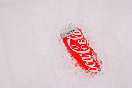 PATTAYA, THAILAND -April 3, 2015: Coca-Cola new design can package on ice background. Coca-Cola is a carbonated soft drink sold very well in Thailand and throughout the world.