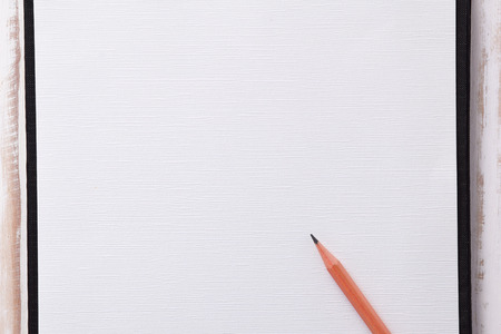 screenplay: pencil on blank paper note on wood tableMake a note of creativity idea. Stock Photo