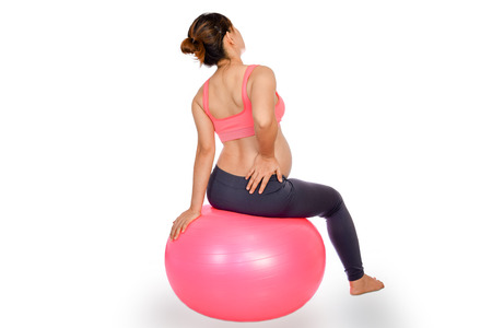 backpain: Pregnant woman yoga with exercise gymnastic ball