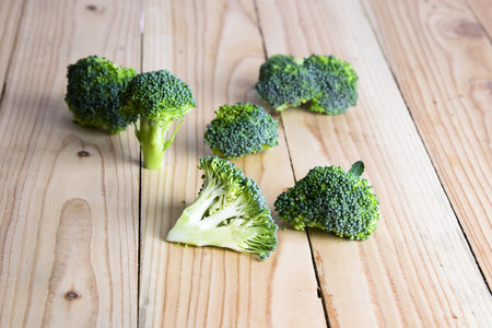 cruciferous: Fresh broccoli on the wooden table