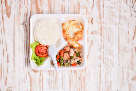 foam box: Lunch box,Basil Fried Rice with mixed seafood,in the foam box.