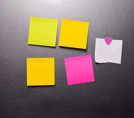 yellow tacks: Blank Post it Note With  On The refrigerator Stock Photo