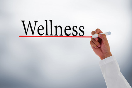 health care decisions: Wellness,Doctor hand writing Wellness message.
