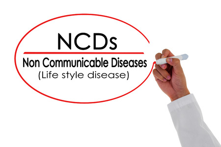 hand writing: NCDs,Doctor hand writing Non Communicable Disease message.