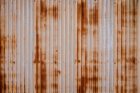 steel texture: heavy duty rusty metal background with non slip repetitive patten. Concept image for urbanization, steampunk, construction, safety at work, oxidation.