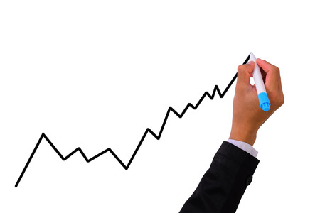 financial market: Business hand with pen marker writing a diagram  graph
