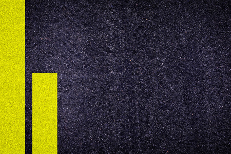 yellow line: Rough asphalt textured ground with yellow line background.