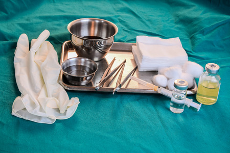 syring: Close up of dressing set often used supplies in a medical for cleaning wounds (Shallow DOF)