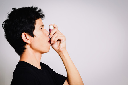 inhaled: Patient use Inhaled Steroids for treat Asthma Stock Photo