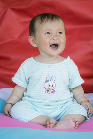 six months: Full body Six months old Asian baby girl first sitting