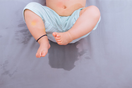 Asian baby happy lying after  bedwetting