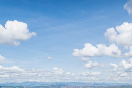 fluffy clouds: Real soft white clouds against blue sky with copy space for background design