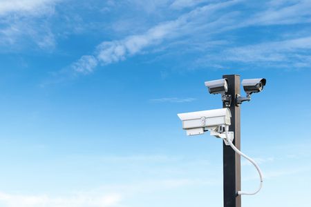 deterrent: Security cctv surveillance camera over  blue sky with copy space Stock Photo