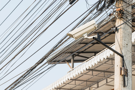larceny: Surveillance Security Camera or CCTV in for protection system on the pole Stock Photo
