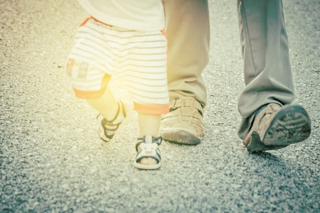 first move: Blurred  of first steps of baby with father support ,concept for toddler move