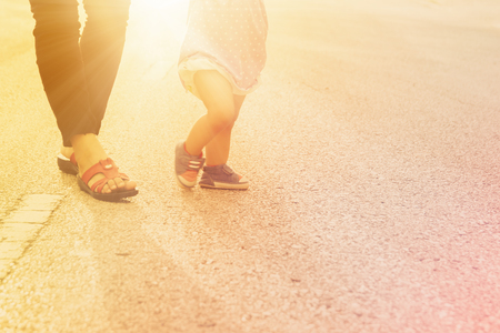 first move: Blurred  of first steps of baby with mother support ,concept for toddler move Stock Photo