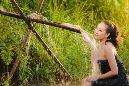 female in douche: Sexy woman bathing in cascade at in the countryside in asia Stock Photo