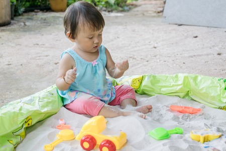 Baby playing toys in sand at home, Sand play is fantastic in aiding a toddler s development and it is such a fun activity to boot