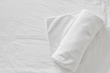 bed sheet: towels on bed sheet decorative at home stay