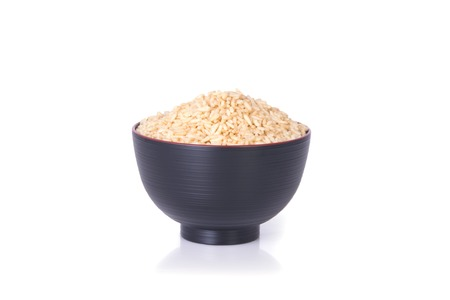 milled: Milled rice in cup container on white background Stock Photo