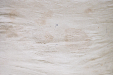 Body oil stains,odors and stains,other dirt on white bedding sheet,unclean bed sheet Stock fotó