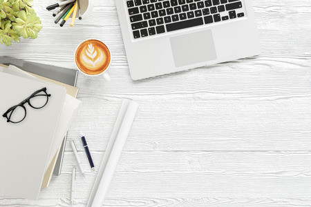 lay: Office desk wood table with labtop computer,blank magazine smart phone eyeglasses and coffee cup Top view with copy space,3D rendering Stock Photo