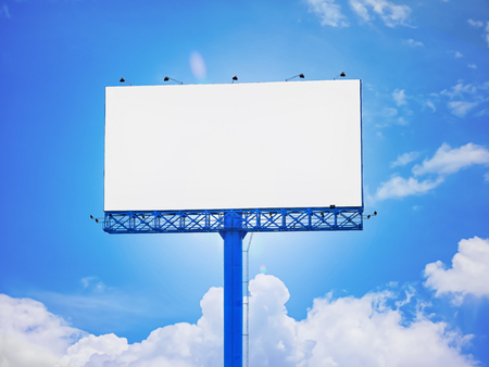 Blank advertisement billboard of blue sky background purposely for adding or applying advertising pictures, graphics, or images on white area.