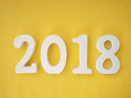 2018 wood letters on gold glitter table for 2018 new year background concept
