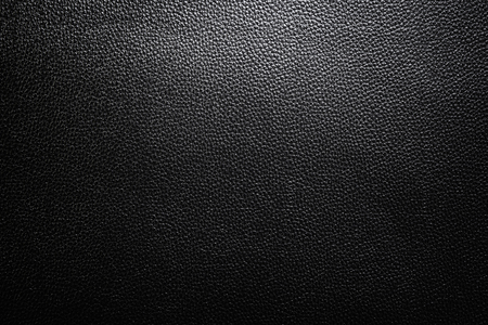 Black Leather Texture with gradient light used as luxury classic Background Design Stock Photo
