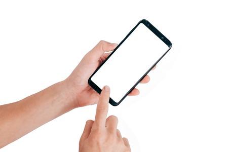 Smartphone Mock up, main tenant le téléphone portable et en utilisant l'écran tactile isolé sur fond blanc avec un tracé de détourage pour la conception Banque d'images - 88610420