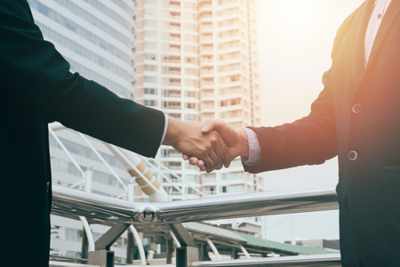 business man hand shaking closing a deal ,business team partnership concept Stock Photo