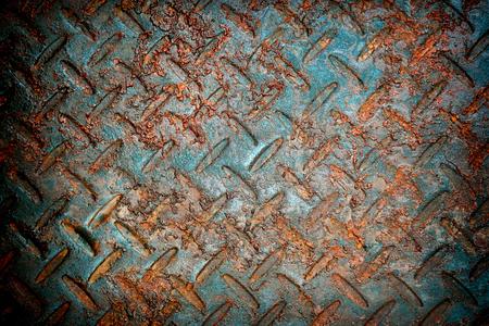 grunge texture rusty metal plate orange oxidized steel iron high resolution graphics background. Stock Photo