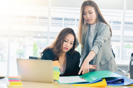 Asian business woman manager give an order to secretary in a modern office business