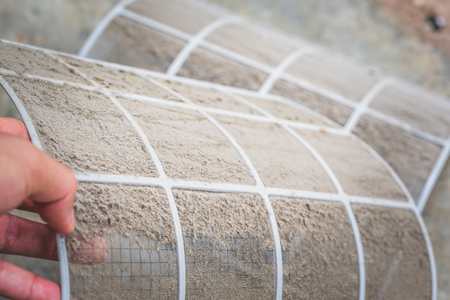Close up dirty dust on air conditioner filter ,Cleaning or changing the filter in the air conditioning for safe healthy housing air conditioning. Stock Photo