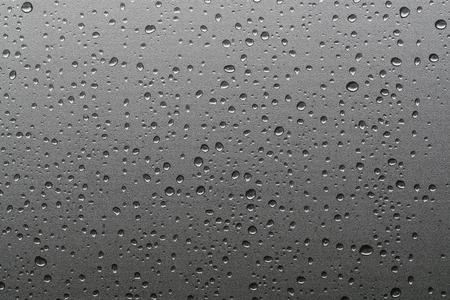 Rain drops on window glasses natural pattern of raindrops background Фото со стока