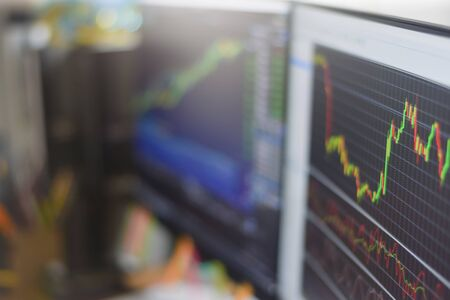 financial stock market graph chart investment trading stock exchange trading market on monitor screen at night time