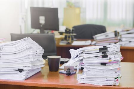 Heap of paperwork stack documents on office desk ,business documents billing and examination to report the summary results annual report for presented. Business offices concept