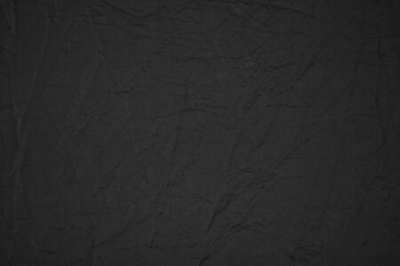 Black canvas fabric texture background use us design backdrop or overlay design. 版權商用圖片