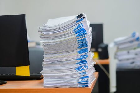 Heap of papers work stack documents on office desk ,business documents billing and examination to report the summary results annual report for presented. Work park offices concept background
